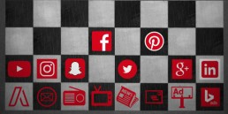 A chessboard with social icons depicting digital first